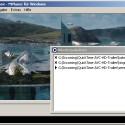 MPUI in deutscher Sprache. Der Player gibt gerade einen H.264-Filmtrailer in 720p-Auflösung wieder. Im Vordergrund sieht man die Wiedergabeliste.