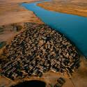 Eine Stadt am Fluss Niger (Quelle: Yann Arthus-Bertrand).