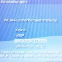 """Die PSP zeigt die am Router vorgefundene Verschlüssellung an. Die Richtungstaste """"rechts"""" führt zur Passworteingabe."""