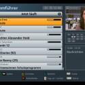 Der elektronische Programmführer zeigt bis zu zwölf Sendungen gleichzeitig an und ermöglicht Aufnahmeprogrammierungen bis zu 14 Tage vorher.