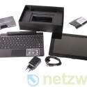 Ein Putztuch und ein USB-Ladekabel sowie ein passendes Netzteil gehören zum Lieferumfang.