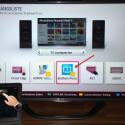 """Möchtest du das Video auf deinem TV-Gerät ansehen, musst du mit der Fernbedienung deines Fernsehers das Menü für die Eingangsliste aufrufen. Hier wird die App """"iMediaShare"""" erkannt. Starte danach an deinem iOS-Gerät die Wiedergabe der Videodatei mit einem Klick."""