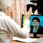 """Aus der Botschaft heraus startete Assange eine TV-Serie. Sayyid Hassan Nasrallah war der erste Gesprächspartner in """"The World Tomorrow""""."""