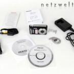 Lieferumfang der Pentax Optio V20: Kamera, Akku, Ladegerät, USB- und AV-Kabel, Handbücher und Software.