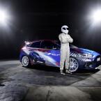 """...der aus der BBC-Serie Top Gear bekannte, stets mysteriöse Rennfahrer """"The Stig"""" zeigte den Wagen."""