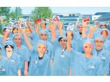 Bild: Bürgerrechtsorganisationen kritisieren die Arbeitsbedingungen bei Nokia und Samsung.