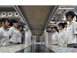 Bild: Foxconn geriet in der Vergangenheit immer wieder wegen katastrophalen Arbeitsbedingungen in die Negativschlagzeilen