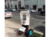 Bild: Yoppi wartet als erster Mensch der Welt auf das iPhone 6.