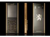 Bild: Das Handy steckt in einem Gehäuse aus Saphir-Glas, mit vergoldeten Tasten.
