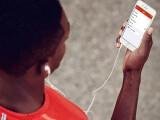 Bild: Die iOS-App von Nike+ Running spielt jetzt Spotify-Streams ab.