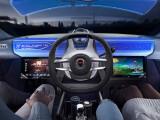 Bild: Für mehr Beinfreiheit: Das Lenkrad lässt sich im Rinspeed XchangE verschieben. Bei Bedarf kann auch der Beifahrer übernehmen.