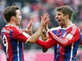 Bild: Mario Götze und Thomas Müller feiern den Heimsieg gegen den Hamburger SV. Triumphieren die Bayern auch gegen Schachtar Donezk in der Champions League?