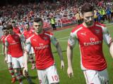Bild: Die Spieler des FC Arsenal betreten in FIFA 15 den Rasen. Im Hintergrund schaut Mesut Özil etwas grimmig drein.