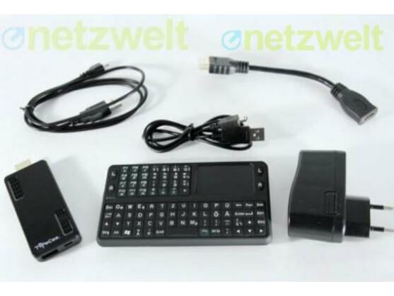 Der Android-HDMI-Stick TVPeCee MMS-874.Dual-Core zusammen mit Zubehör. Die Funktastatur befindet sich nicht im Lieferumfang.